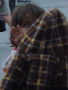 Child Trying To Put His Own Coat On: Quito, Ecuador