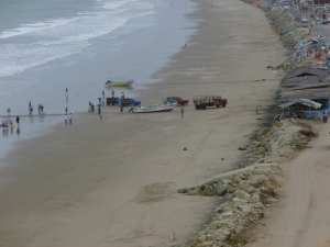 Early Morning fishing Boats: Crucita, Ecuador - Trucks drag the fishing boats up off the beach with a tow line.