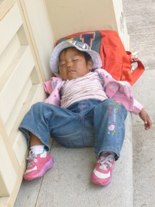 Sleeping Child In A Doorway: Cumbaya, Ecuador