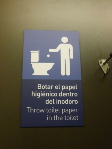 Bathroom Stall Sign: Quito Airport, Quito Ecuador