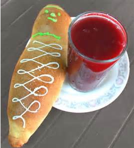 Colada Morada and Bread in the Shape of a Person served in Ecuador on Day Of The Dead